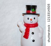 toy snowman waving with white... | Shutterstock . vector #1213314505