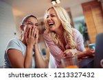 two happy women looking at... | Shutterstock . vector #1213327432