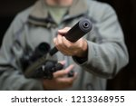 military holds a pistol with a... | Shutterstock . vector #1213368955