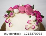 cake with roses and macaroons | Shutterstock . vector #1213370038