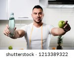 bottle of water and an apple... | Shutterstock . vector #1213389322