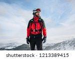 A Ski Patrol Member Top Of...
