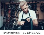 young mechanic repairs bicycle... | Shutterstock . vector #1213436722
