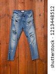denim bib isolated on wooden...   Shutterstock . vector #1213448512