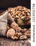 walnut kernels whole walnuts in ... | Shutterstock . vector #1213531738