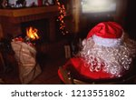 santa claus is watching tv in... | Shutterstock . vector #1213551802