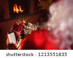 santa claus is sitting in front ... | Shutterstock . vector #1213551835