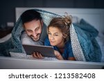 adorable young relaxed couple... | Shutterstock . vector #1213582408