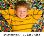 happy little boy with smiley... | Shutterstock . vector #1213587355