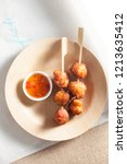 Fried Fish Balls On A Wooden...