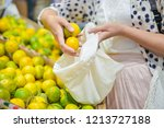 woman is selecting fruits in... | Shutterstock . vector #1213727188
