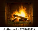 flames in a wood burning fire... | Shutterstock . vector #1213784365