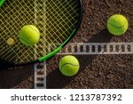 tennis balls on a tennis court | Shutterstock . vector #1213787392