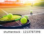 tennis balls on a tennis court | Shutterstock . vector #1213787398