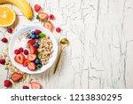 granola with berries  yoghurt... | Shutterstock . vector #1213830295