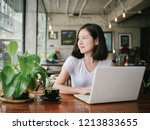 asian woman drinking coffee and ... | Shutterstock . vector #1213833655