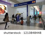 Small photo of London, UK - October 6, 2018: Air travellers proceed to passport control at Heathrow airport. The immigration status of EU citizens remains unclear following Brexit.
