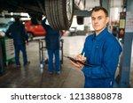 repairman with notebook fills... | Shutterstock . vector #1213880878