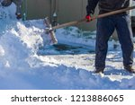 man cleans the road from snow... | Shutterstock . vector #1213886065