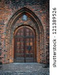 An Arched Doorway To A Gothic...
