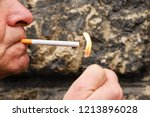 adult man lighting up the... | Shutterstock . vector #1213896028