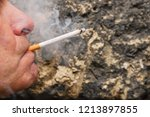 adult man smoking cigarette and ... | Shutterstock . vector #1213897855