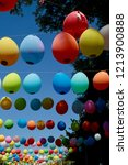 colored balloons hanging on a... | Shutterstock . vector #1213900888