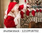 merry christmas. santa claus at ... | Shutterstock . vector #1213918702