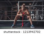 afro american boxer is wrapping ... | Shutterstock . vector #1213942702