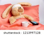 a toy unhealthy rabbit with a... | Shutterstock . vector #1213997128