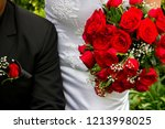 bride holding rose bouquet next ... | Shutterstock . vector #1213998025
