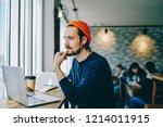 pensive hipster guy in earphone ...   Shutterstock . vector #1214011915