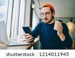 emotional hipster guy amazed... | Shutterstock . vector #1214011945