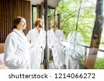 young couple in bathrobes... | Shutterstock . vector #1214066272