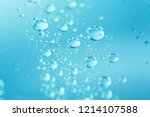 Water Droplet On Blue Background