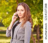 young girl talking cellphone....   Shutterstock . vector #1214137288