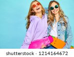 two young stylish smiling blond ... | Shutterstock . vector #1214164672