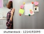 woman opening refrigerator door ... | Shutterstock . vector #1214192095