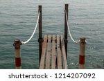 empty small pier on garda lake... | Shutterstock . vector #1214207092