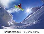 snowboarder jumping against... | Shutterstock . vector #121424542