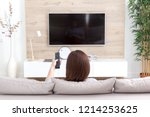 young woman watching tv in the... | Shutterstock . vector #1214253625