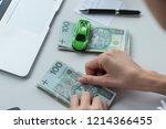woman is calculating her money. ... | Shutterstock . vector #1214366455