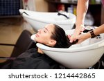 beautiful brunette washes hair... | Shutterstock . vector #1214442865