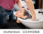 beautiful brunette washes hair... | Shutterstock . vector #1214442868