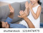 little daughter and father... | Shutterstock . vector #1214476975