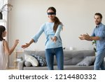 blindfolded mother catching... | Shutterstock . vector #1214480332