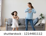cheerful mother little daughter ... | Shutterstock . vector #1214481112