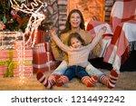 merry christmas. little girl... | Shutterstock . vector #1214492242