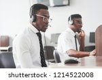 two black workers take calls in ... | Shutterstock . vector #1214522008