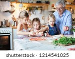 children and grandmother... | Shutterstock . vector #1214541025